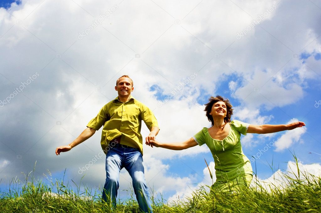 Fun couple in jump on the outdoor background — Stock Photo #6358419