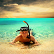 Royalty-Free Stock Photo: Happy young man with snorkelling on a sea beach