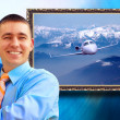 Businessman with picture on background - Stock Photo