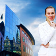 Happiness businesswoman on the business architecture background — Stock Photo #6360190
