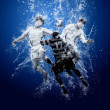 Water drops around football players - Foto Stock