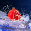 Water drops around red fruit on ice — Foto Stock #6360246