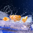 Water drops around fruits on the ice — Stock Photo