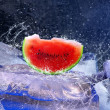 Water drops around watermelon on the ice — Stock Photo #6360258