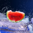 Water drops around watermelon on the ice — Foto Stock