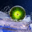 Water drops around watermelon on the ice — Stock Photo