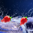 Water drops around strawberry and ice on blue background — Stock Photo #6360263