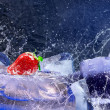 Water drops around red strawberry on the ice — Stock Photo