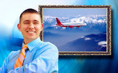 Businessman with picture on background — Stock Photo