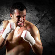 Aggressive boxer with blood on the face — Stock Photo #6370113