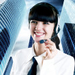 Hapiness Businesswoman standing on the business background — Stock Photo