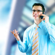 Hapiness Businessman standing on the business background — Stock Photo #6370165