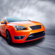 Beautiful orange sport car on road — Foto Stock #6370198