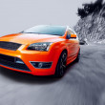 Beautiful orange sport car on road — Stock Photo #6370200