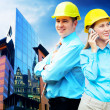 Young architects wearing a protective helmet standing on the bui — Stock Photo #6370220