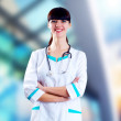 Smiling medical doctor with stethoscope on the hospitals backgro — 图库照片