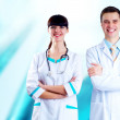 Smiling medical doctor with stethoscope on the hospitals backgro — Foto Stock