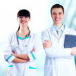 Постер, плакат: Smiling medical doctor with stethoscope on the hospitals backgro
