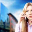 Happiness businesswoman calling by phone on the business archite — Stock Photo #6370272