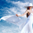 Young beautiful women in the white with pareo on the blue sky ba — Foto Stock