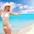 Stock Photo: Young beautiful women in white on sunny tropical beach