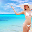 Royalty-Free Stock Photo: Young beautiful women in the white on the sunny tropical beach