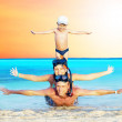 Happy young couple and son with snorkelling on a sea beach — Stock Photo