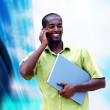 Young happy black man or student with laptop on the business bac — Foto de Stock