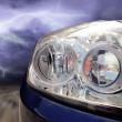 Beautiful sport car on dark sky with lightning - Photo