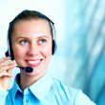 Happiness businesswoman speak in headphones on blur business arc — Stock Photo #6370372