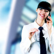 Hapiness Businesswoman standing on the business background — Stock Photo #6370512