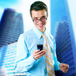 Hapiness Businessman standing on the business background — Stock Photo #6370522