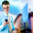 hapiness businessman standing on the business background — Stock Photo