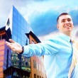 Hapiness Businessman standing on the business background — Stock Photo #6370548