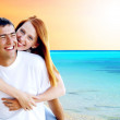 Royalty-Free Stock Photo: Young love couple smiling under tropical beach