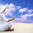 Young beautiful women in white, relaxation at sunny desert — Stock Photo #6370588