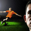Portrait of Soccer player on the field in night rain — Stock Photo #6370612