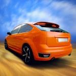 Beautiful orange sport car on road — Stock Photo #6370614
