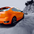 Beautiful orange sport car on road - Stok fotoraf