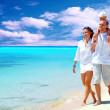 View of happy young family having fun on the beach — Stock Photo #6370623