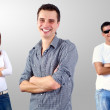 Beautiful smiling group of young standing, white backgrou — Stock Photo
