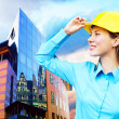 Young architect-woman wearing a protective helmet standing on th — Stock Photo #6370648