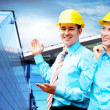 Young architects wearing a protective helmet standing on the bui — Stock Photo #6370655