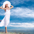 Young beautiful women in the white with pareo on the blue sky ba — Lizenzfreies Foto