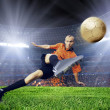 Stock Photo: Football player on field of stadium