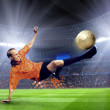 Royalty-Free Stock Photo: Football player on field of stadium