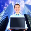 Happiness businesswoman with laptop on blur business architectur — Stockfoto