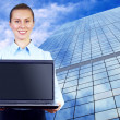 Happiness businesswoman with laptop on blur business architectur — Stock Photo #6370754
