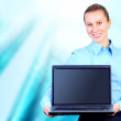 Happiness businesswoman with laptop on blur business architectur — Stock Photo #6370756