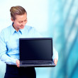Happiness businesswoman with laptop on blur business architectur — Stock Photo #6370757